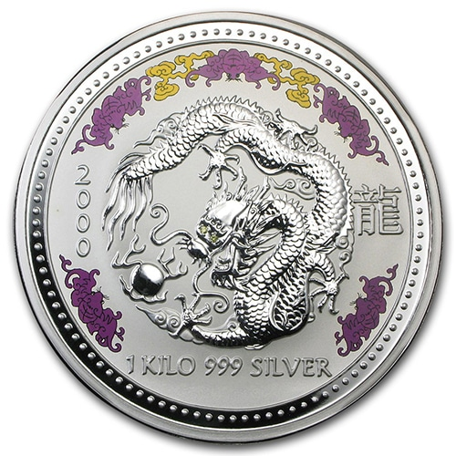 1kg silver coin has a colored border and the Dragon has 02 carat golden colored diamonds for eyes